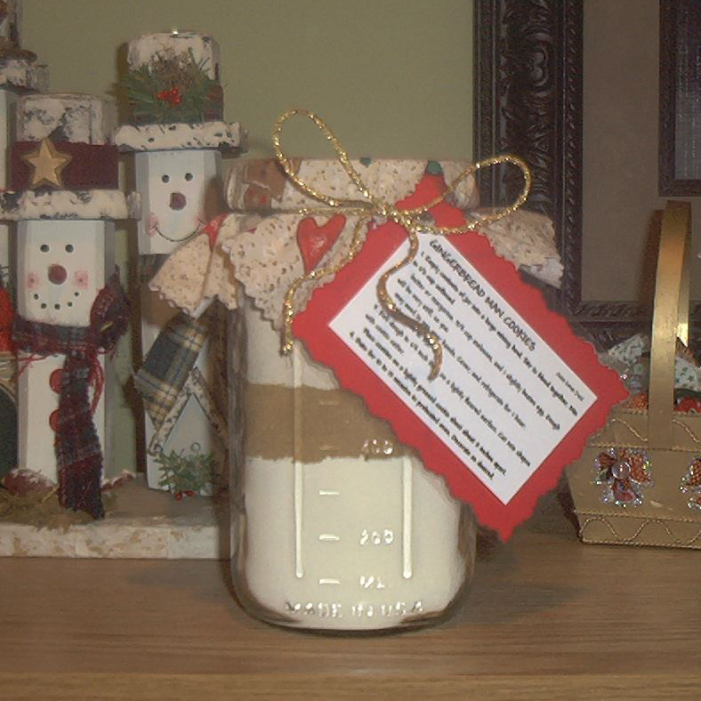 Gingerbread Cookie Mix in a Jar next to two snowman decorations
