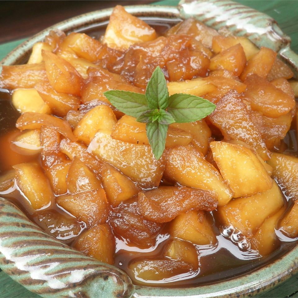 bowl of Apple and Raisin Sauce garnished with mint leaves