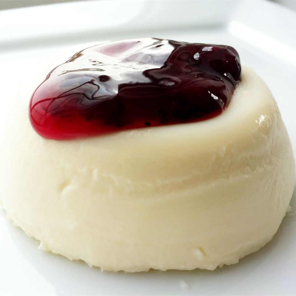 dish of panna cotta with berry compote topping