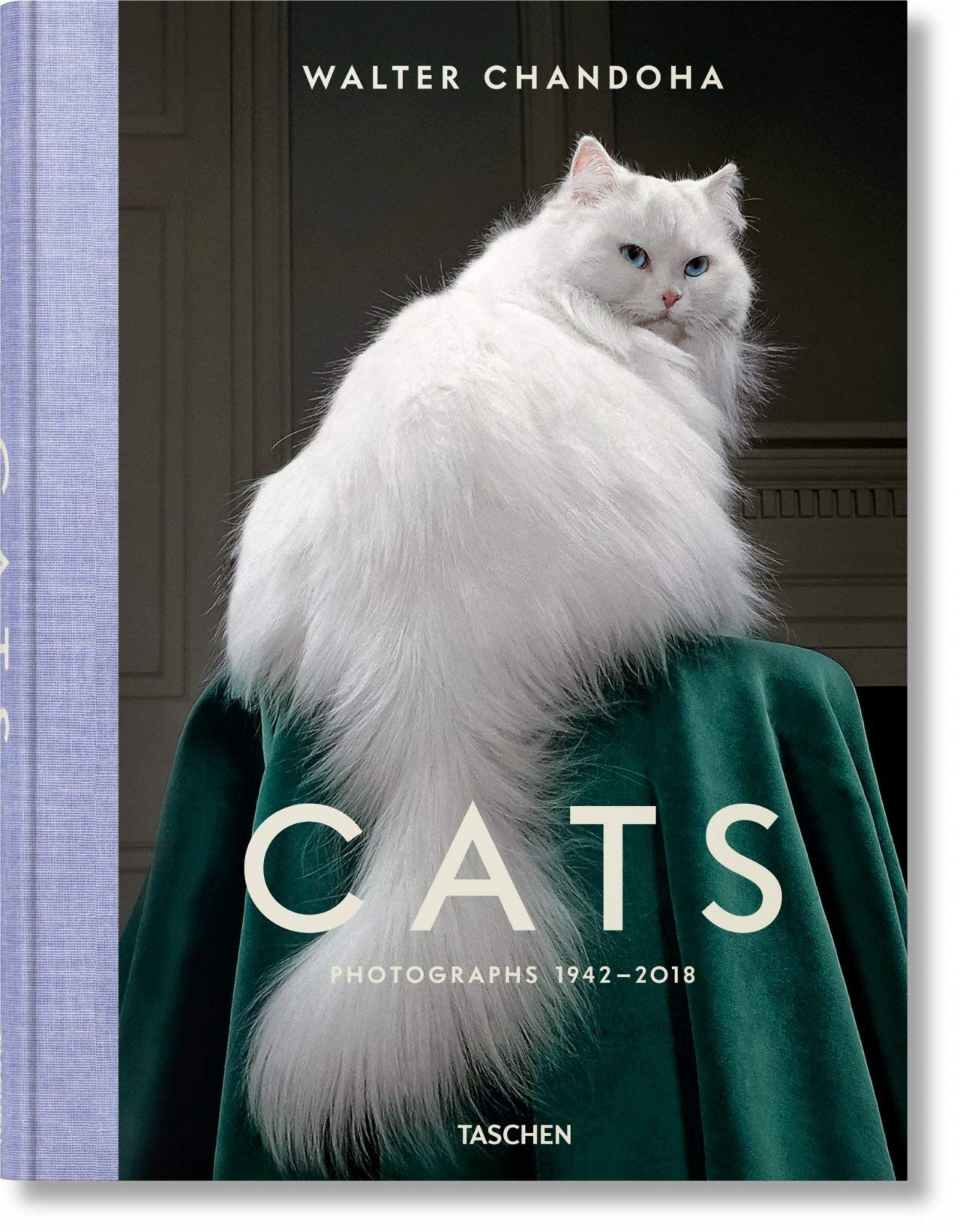 Coffee table book with white cat on cover