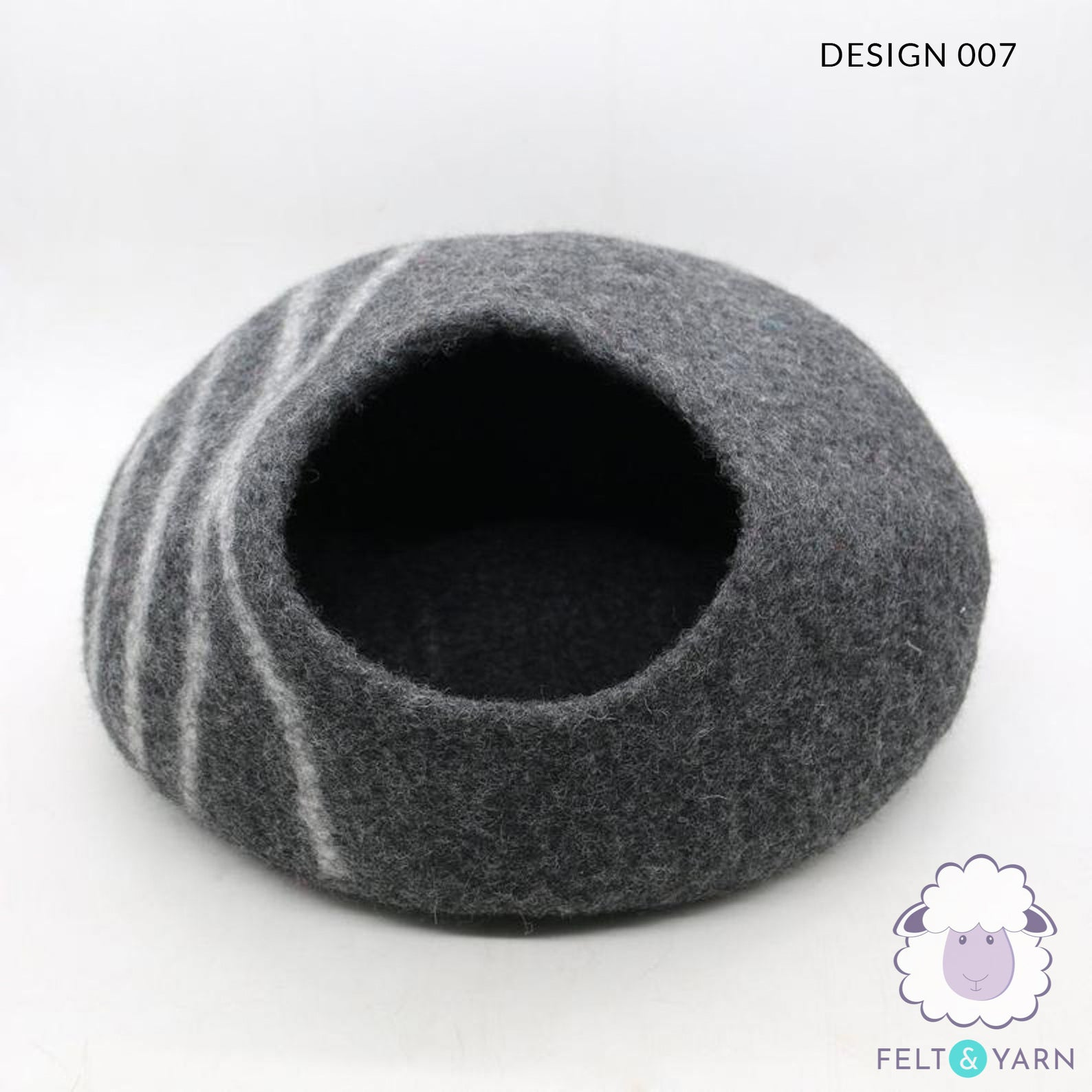 Gray cat cave made out of felt