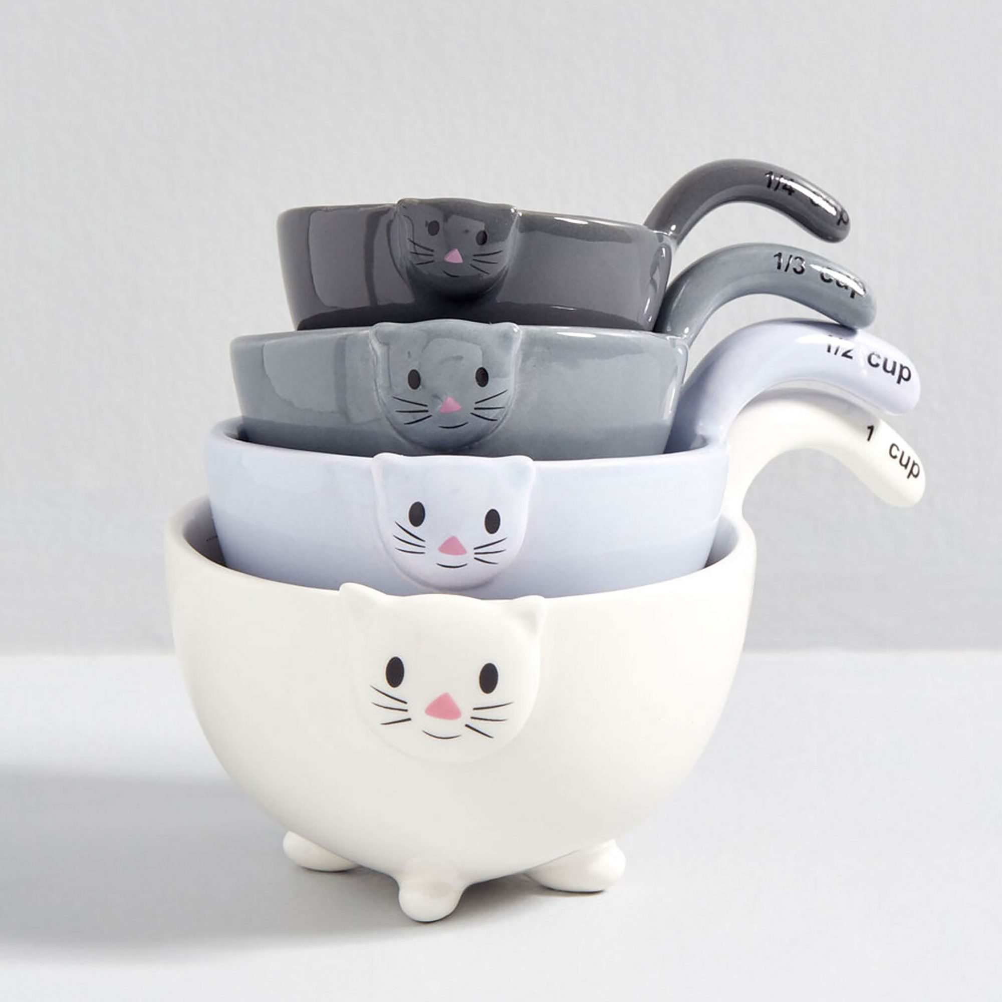 Stack of measuring cups shaped like cats