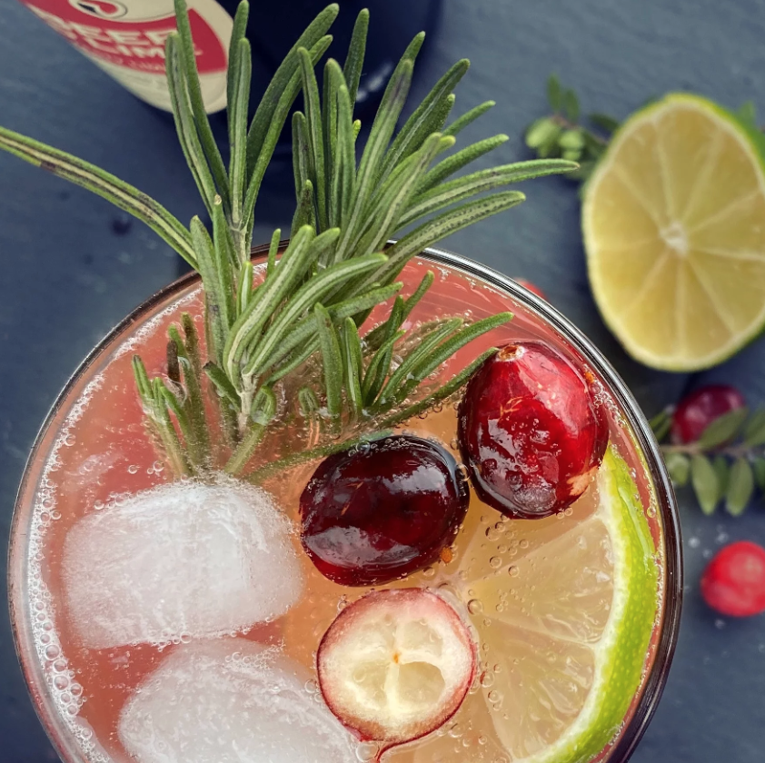 holiday cocktail with berries and rosemary