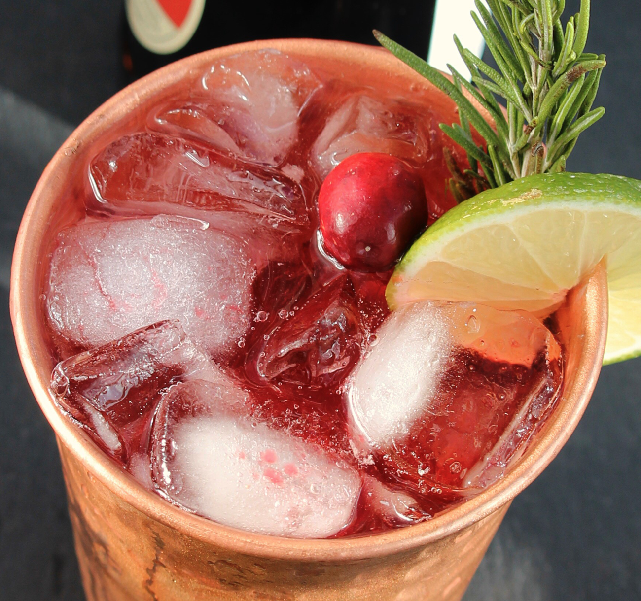 overhead of cranberry moscow mule in copper mug