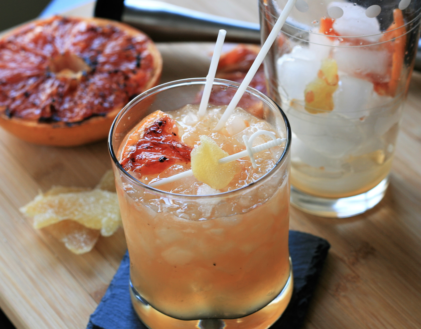 grapefruit cocktail with straw