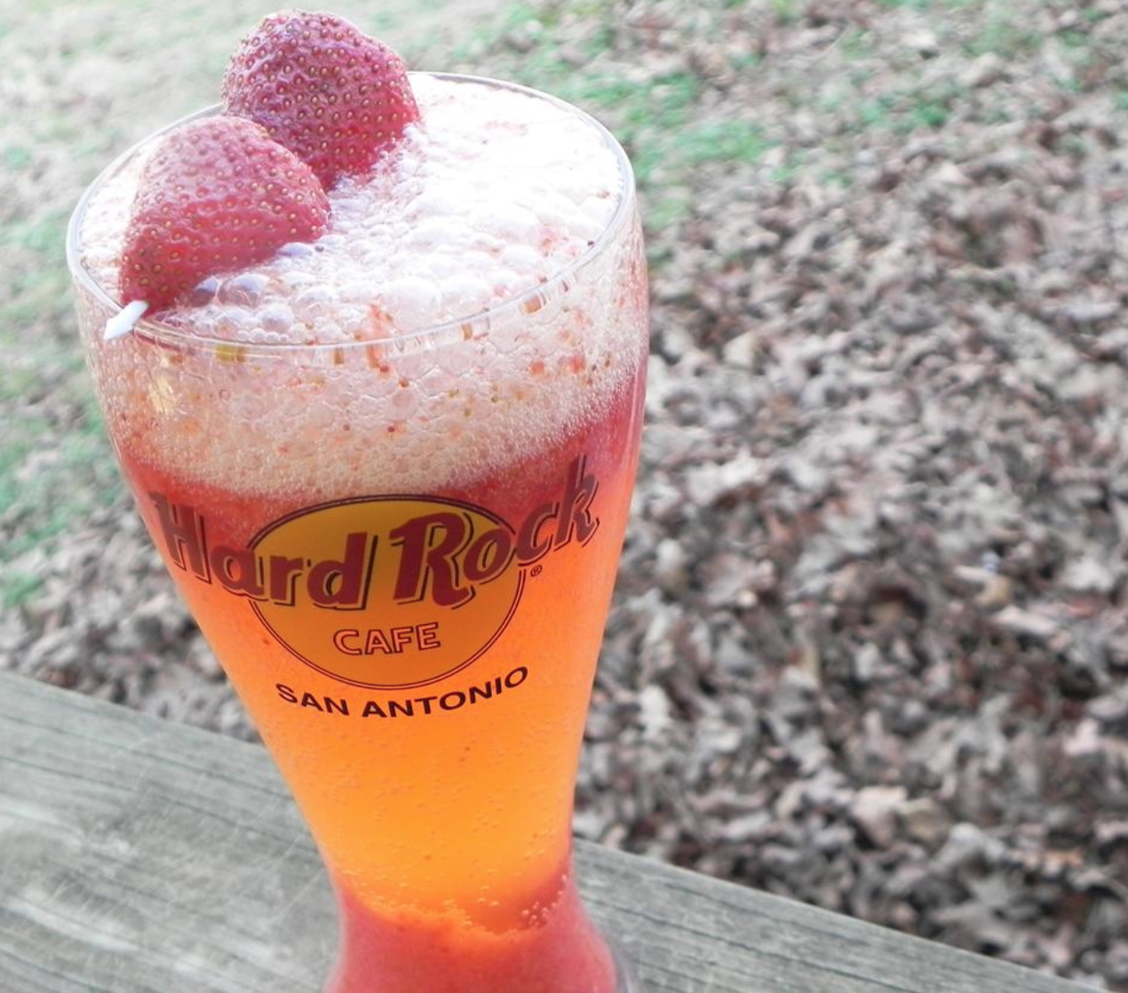strawberry cocktail with raspberries in pint glass