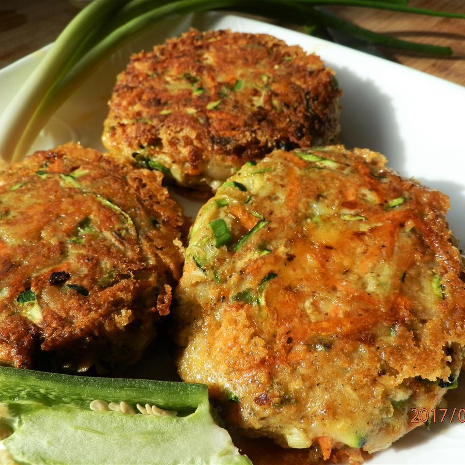 With this recipe, we welcome zucchini and carrot to the latkes party. There's still a bit of shredded potato and eggs, but instead of flour, this recipe adds matzo meal and crumbled feta as two additional binding ingredients. We love the step of salting the vegetables first to extract moisture. And to make sure all of the moisture is extracted, Edna, the Allrecipes member who shares this recipe, repeats the step twice.