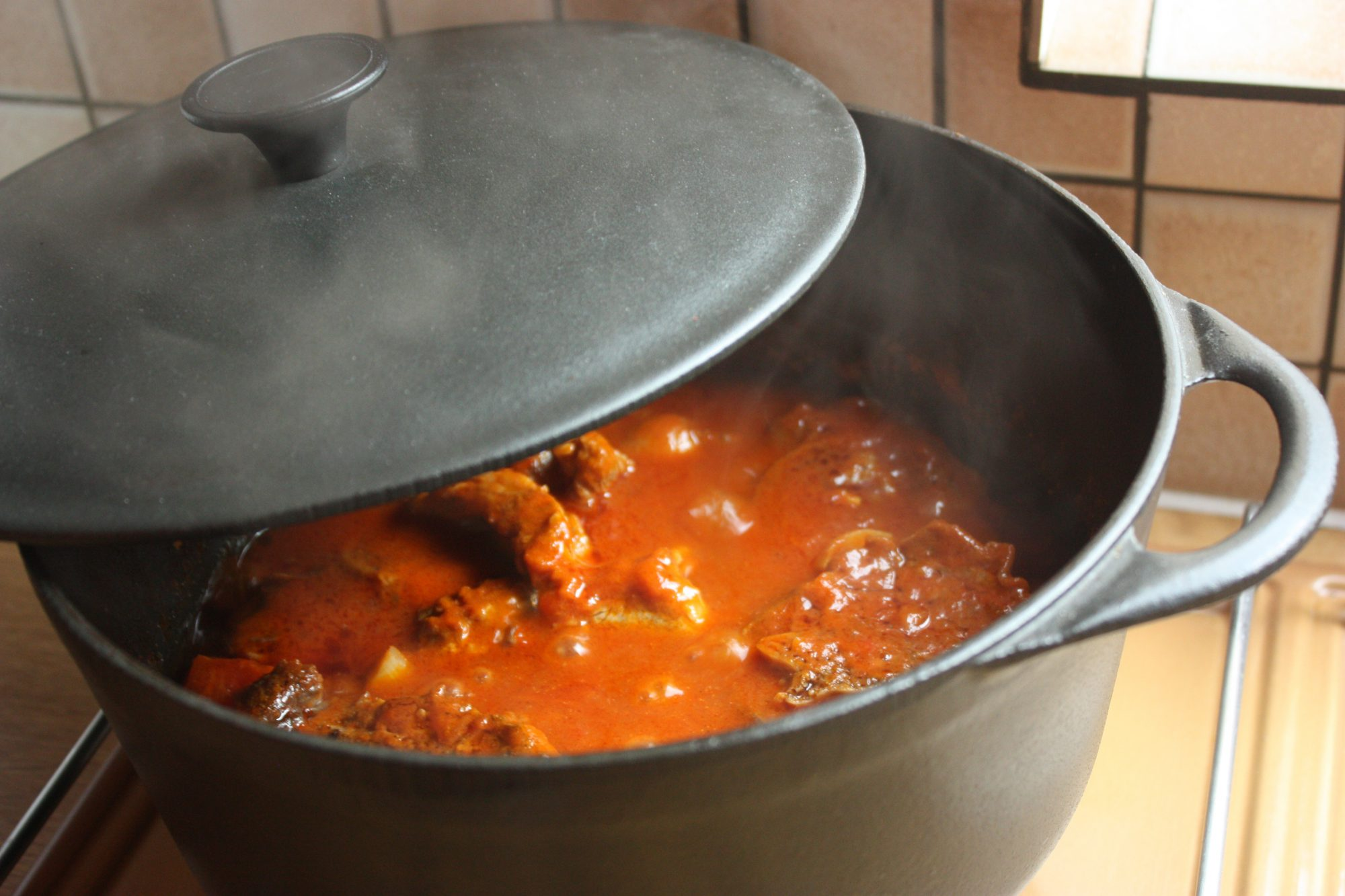 Stew being cooked in a cast iron dutch oven