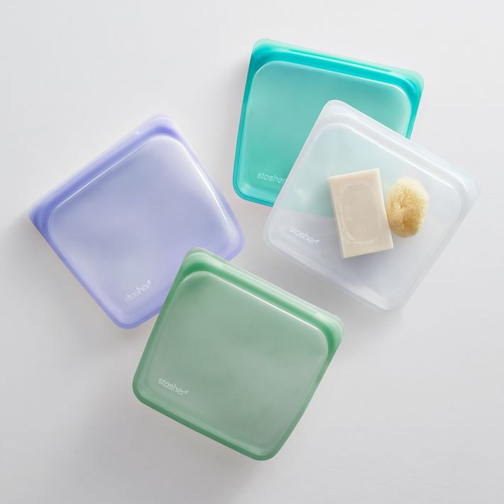 green, teal, purple, and clear Stasher sandwich bags