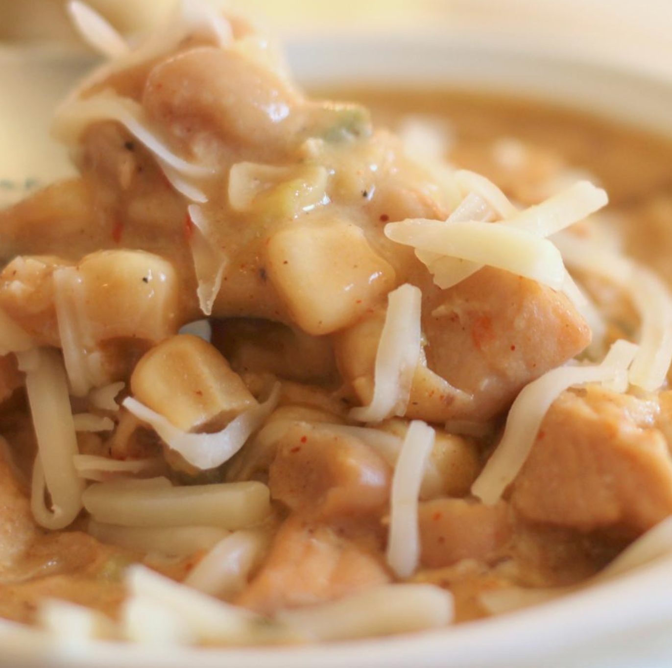 Close up of white chicken chili in white bowl
