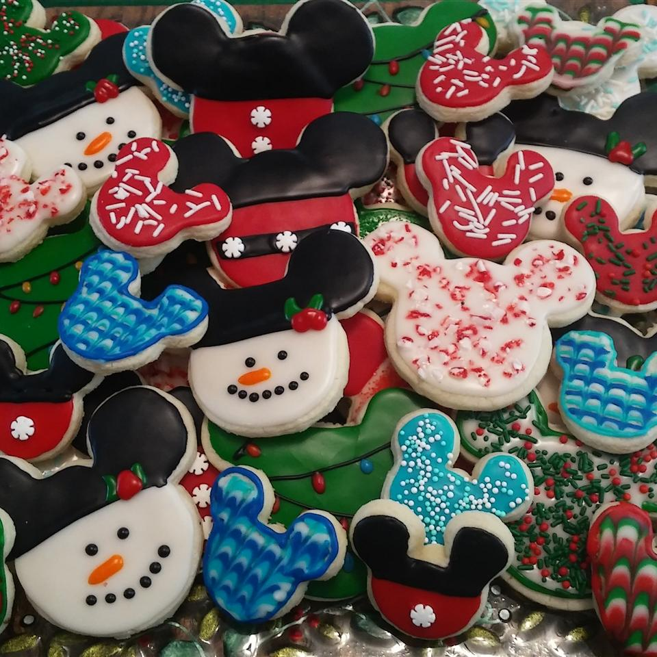 iced mouse shaped cookies with assorted holiday decorative elements
