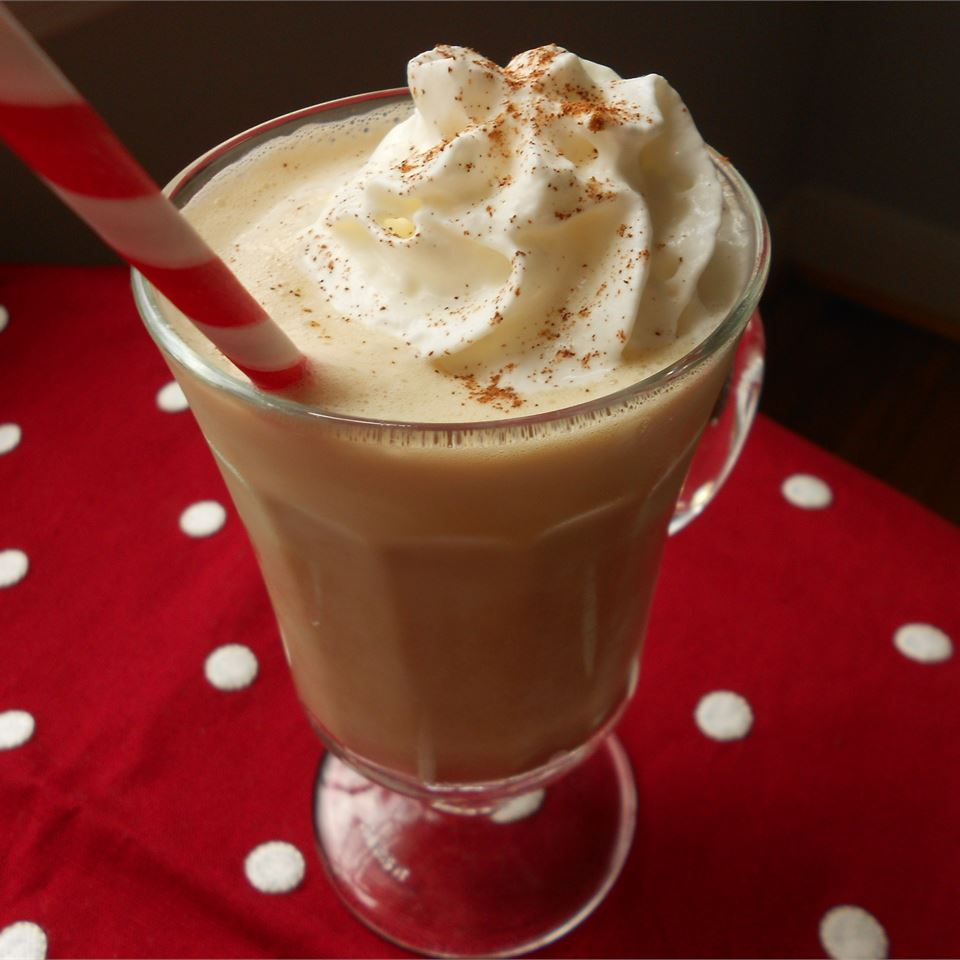 Eggnog coffee drink in glass cup with whipped cream