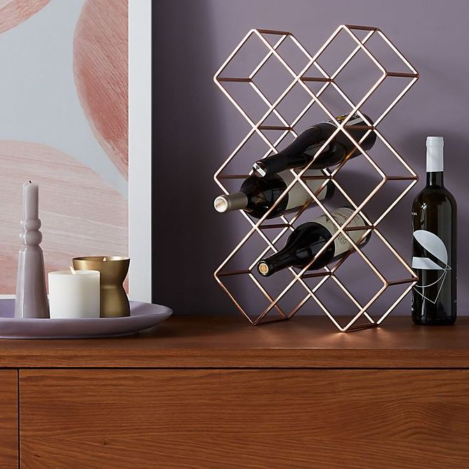 wrought iron wine rack with diamond-shaped slots for bottles