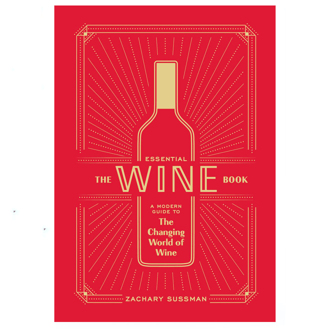 The Essential Wine Book with a red cover
