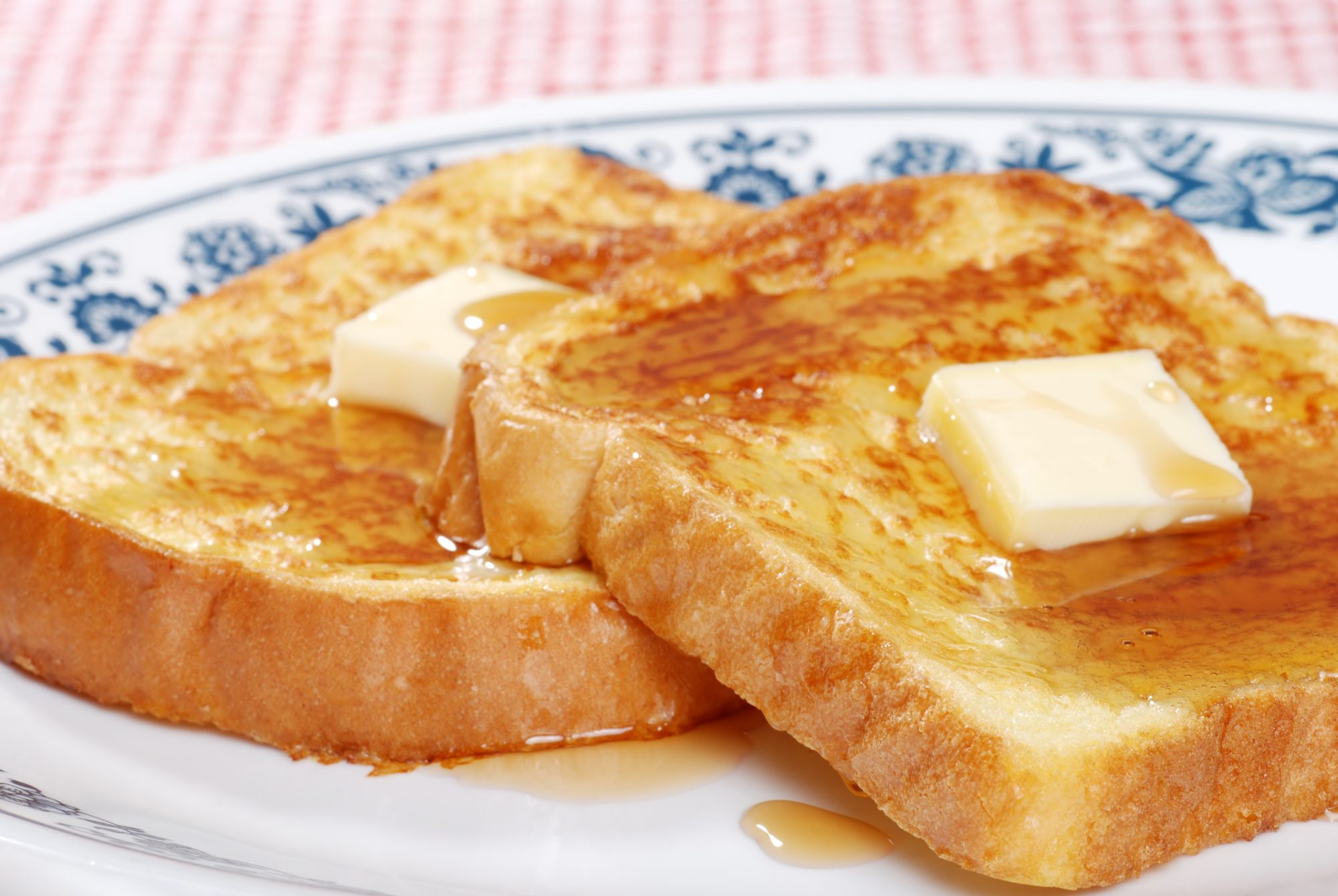French toast on patterned plate with butter