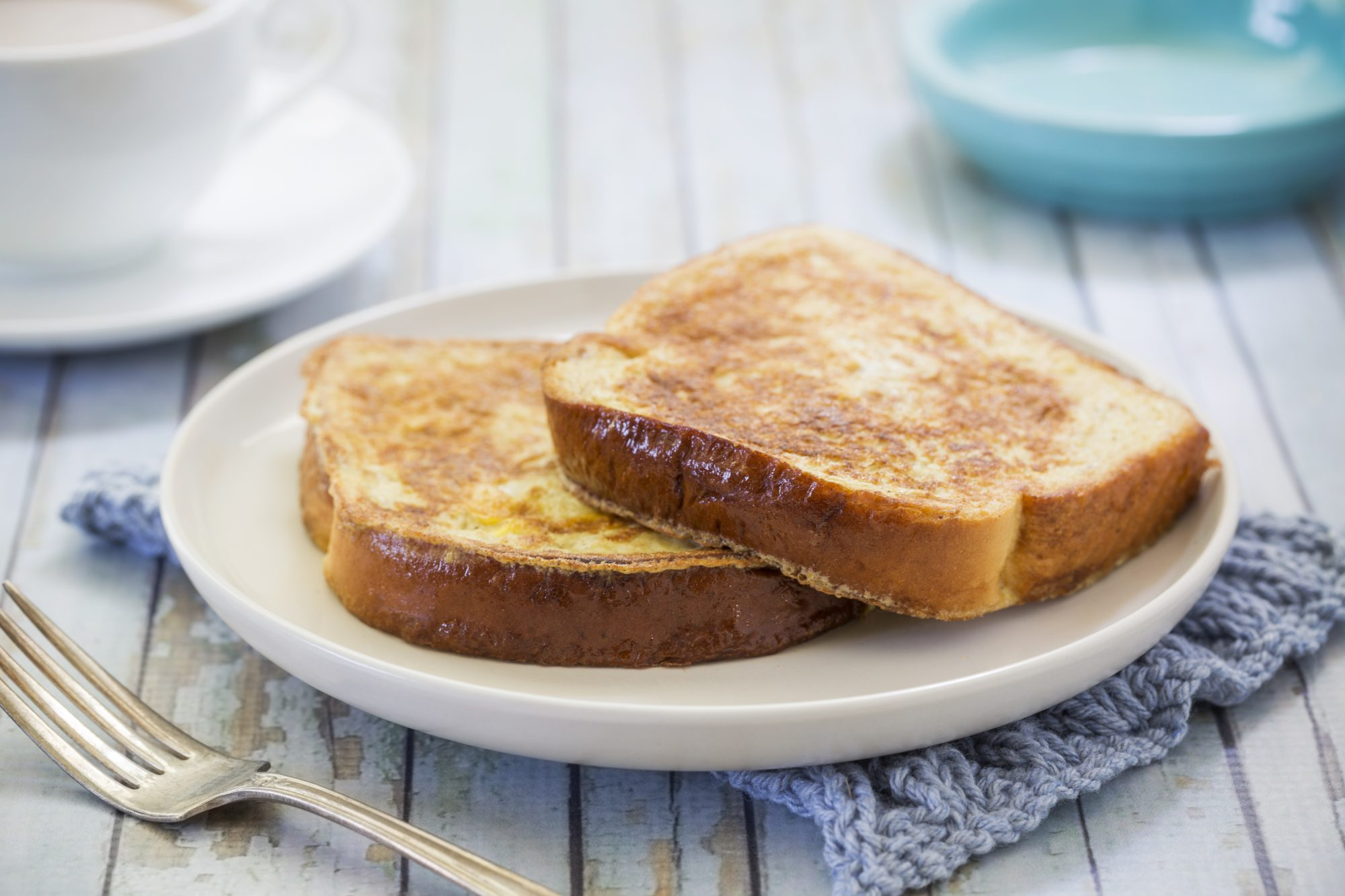 plain French toast on white plate