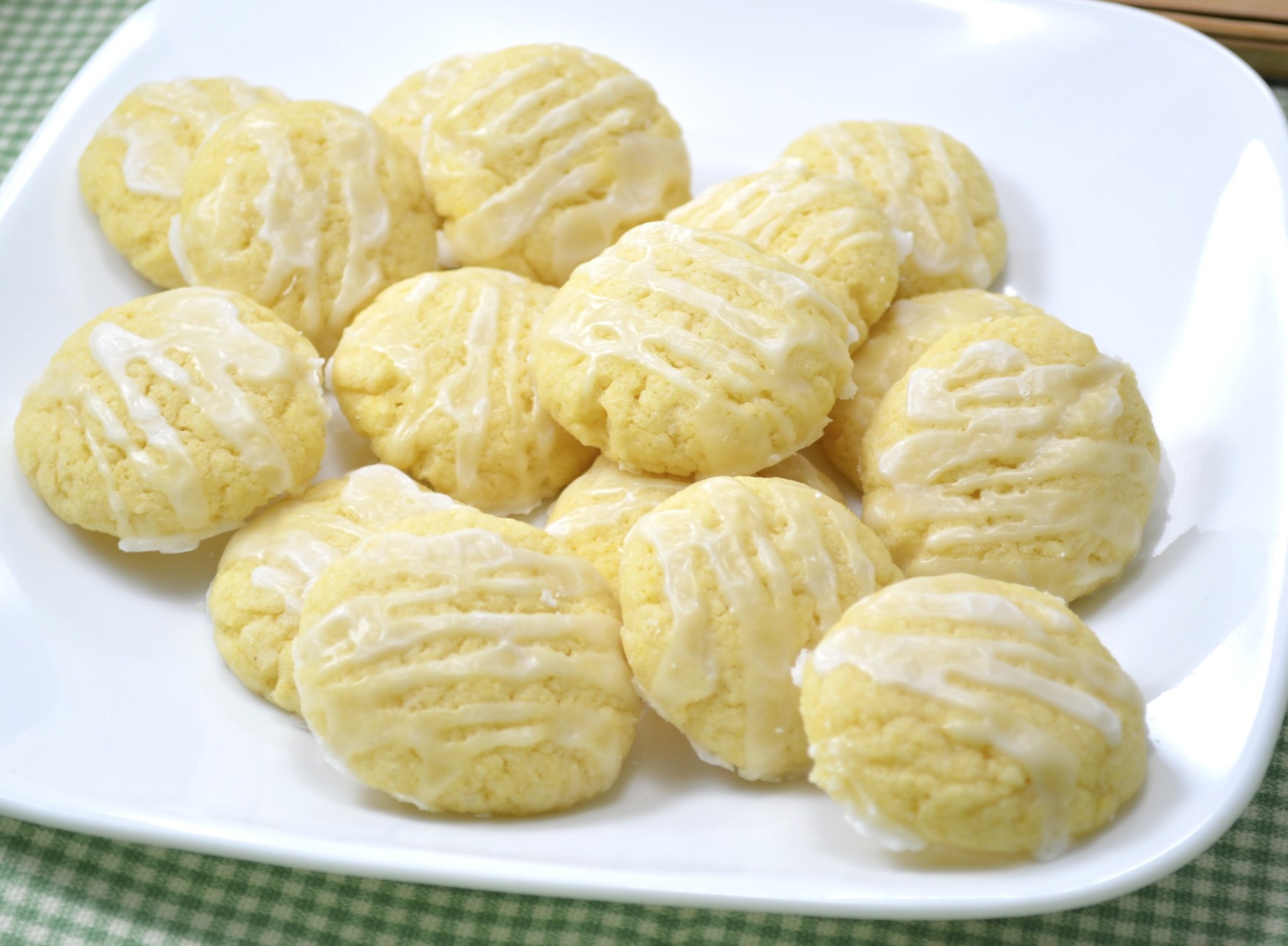 yellow Italian Anisette Cookies with white icing