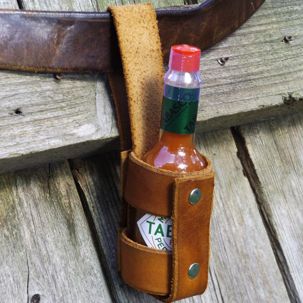 Leather hot sauce holster holding Tabasco