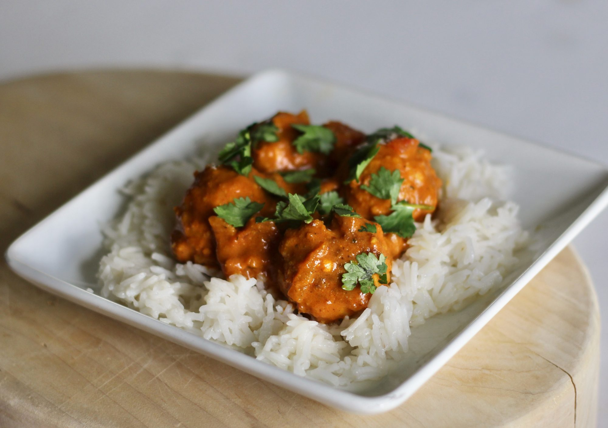 Spicy Chicken Curry Meatballs on a white plate