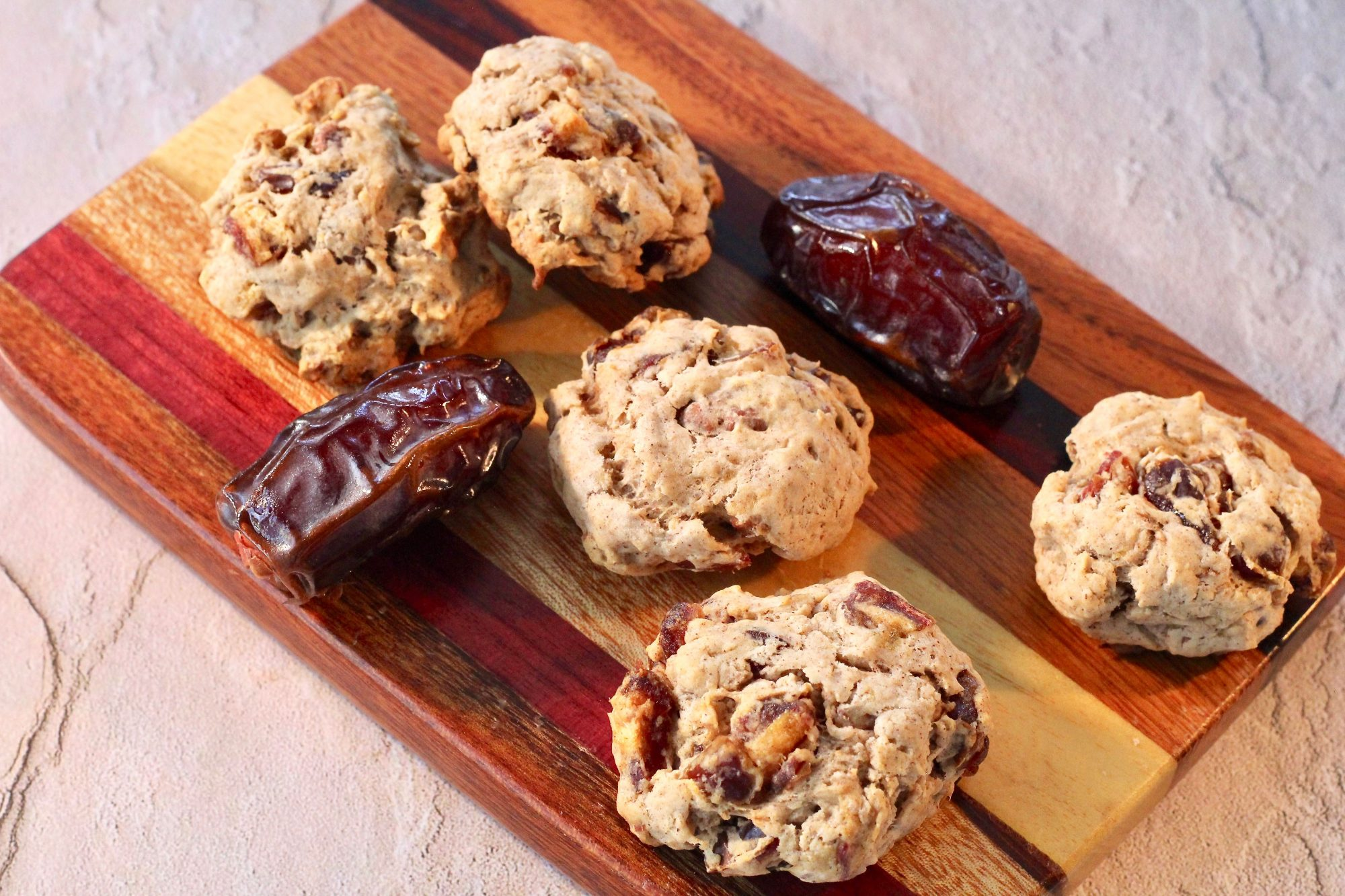 Date cookies and whole dates on wood platter