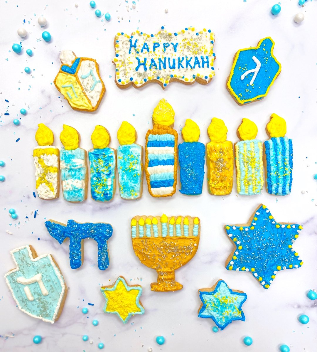 Menorah-shaped cookies with blue and yellow icing