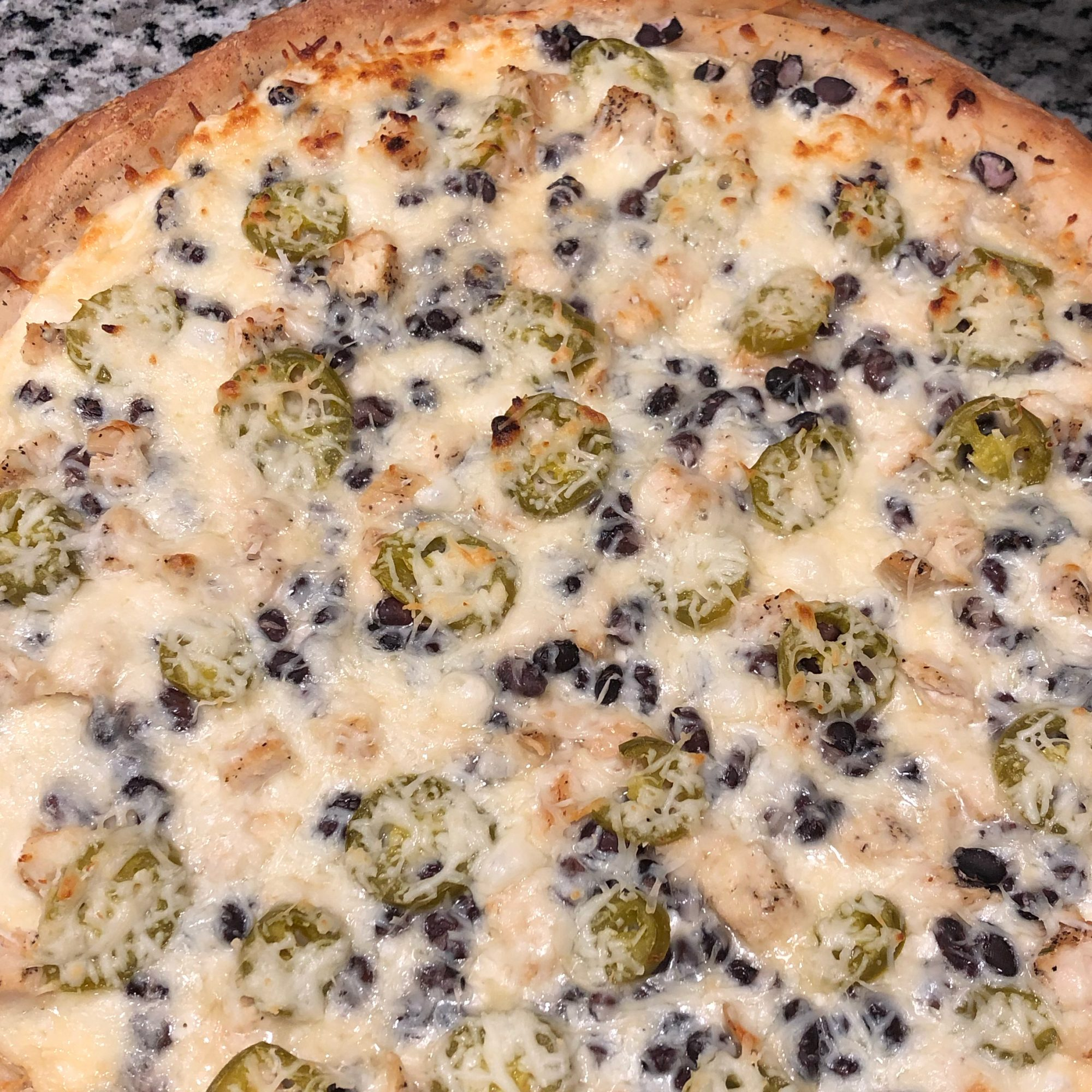 Close up of Black and White Pizza
