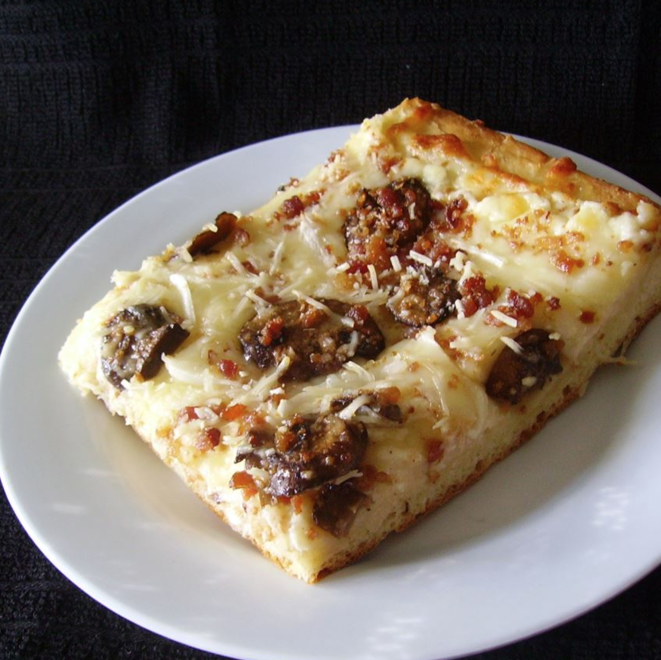 Deep Dish Alfredo Pizza on a white plate