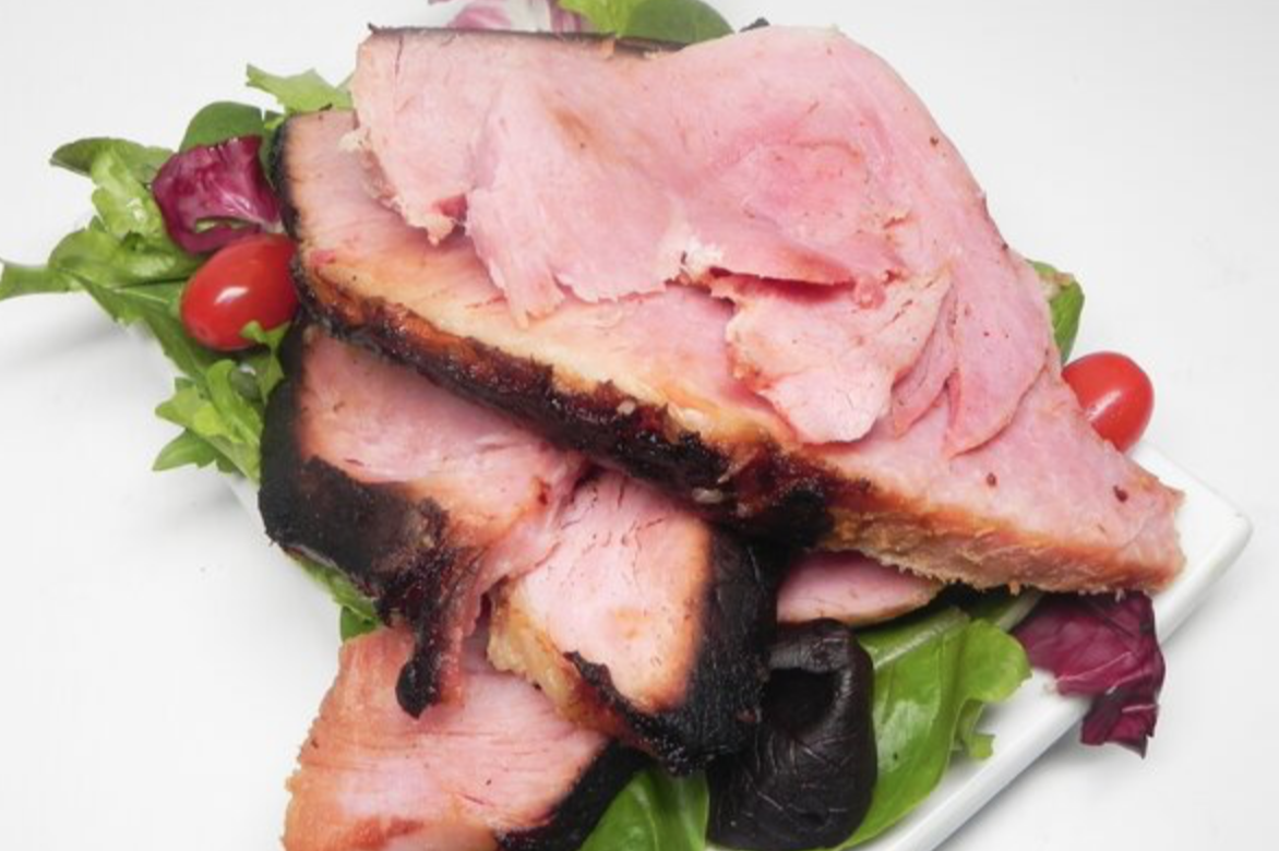 country ham on plate with salad and tomatoes
