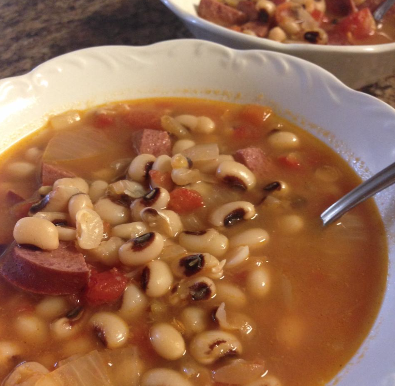 black eyed peas with ham in a bowl with spoon