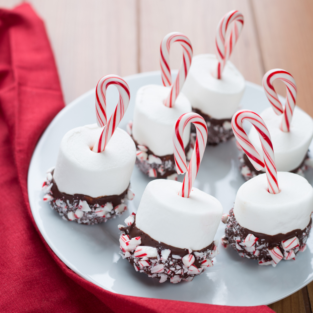 chocolate dipped marshmallows with candy cane decorations