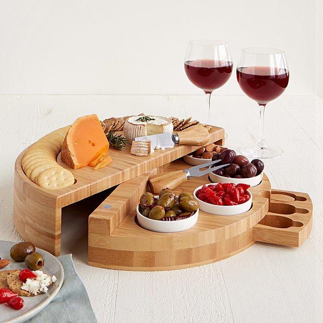 two-tiered cheese and tapas board