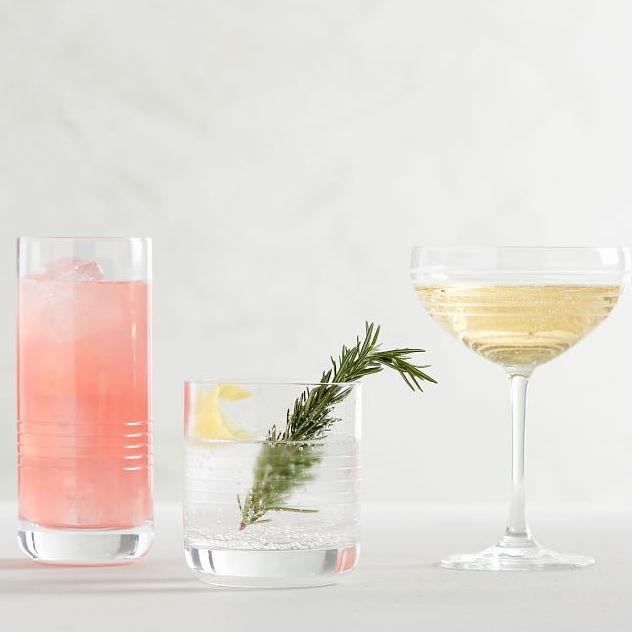 three cocktail glasses with drinks