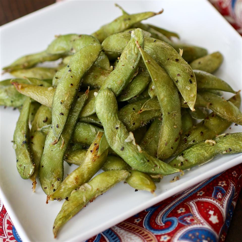 Simple Roasted Edamame on a white plate