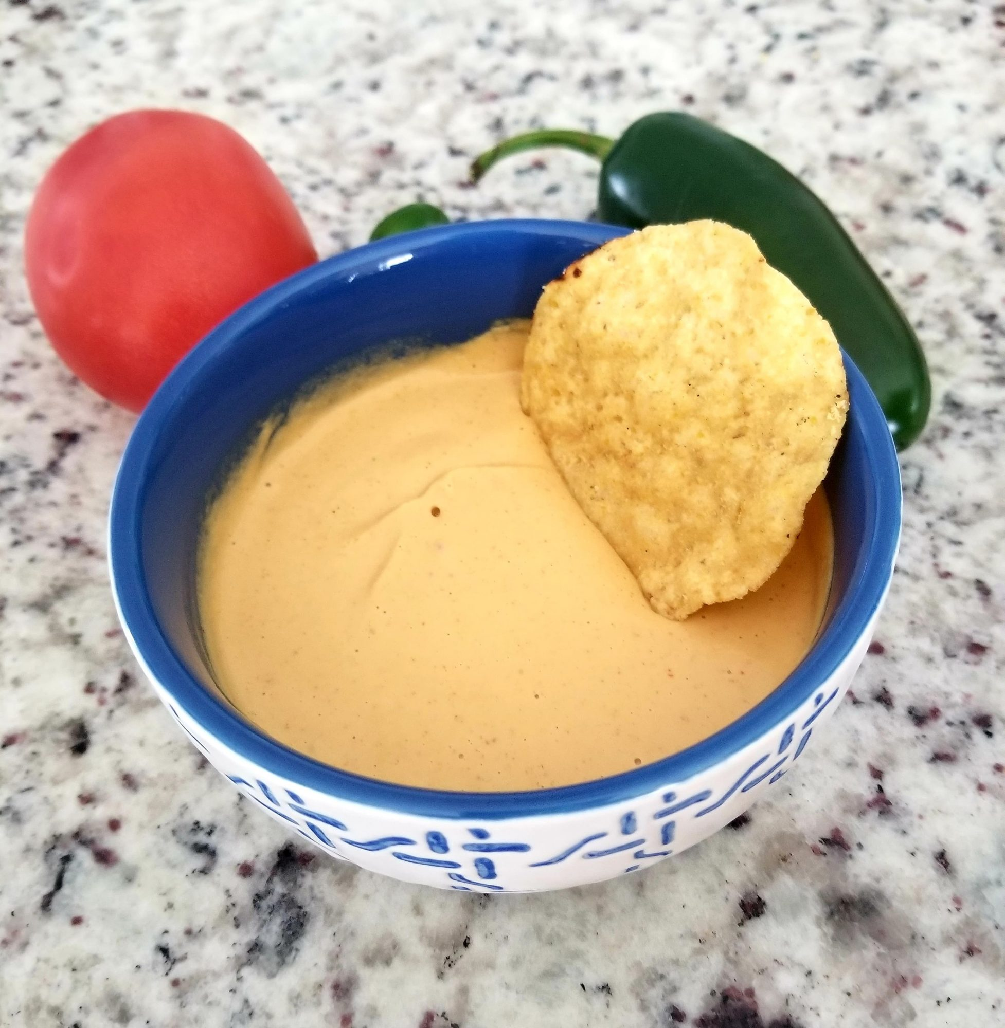 Vegan Queso with chips and veggies