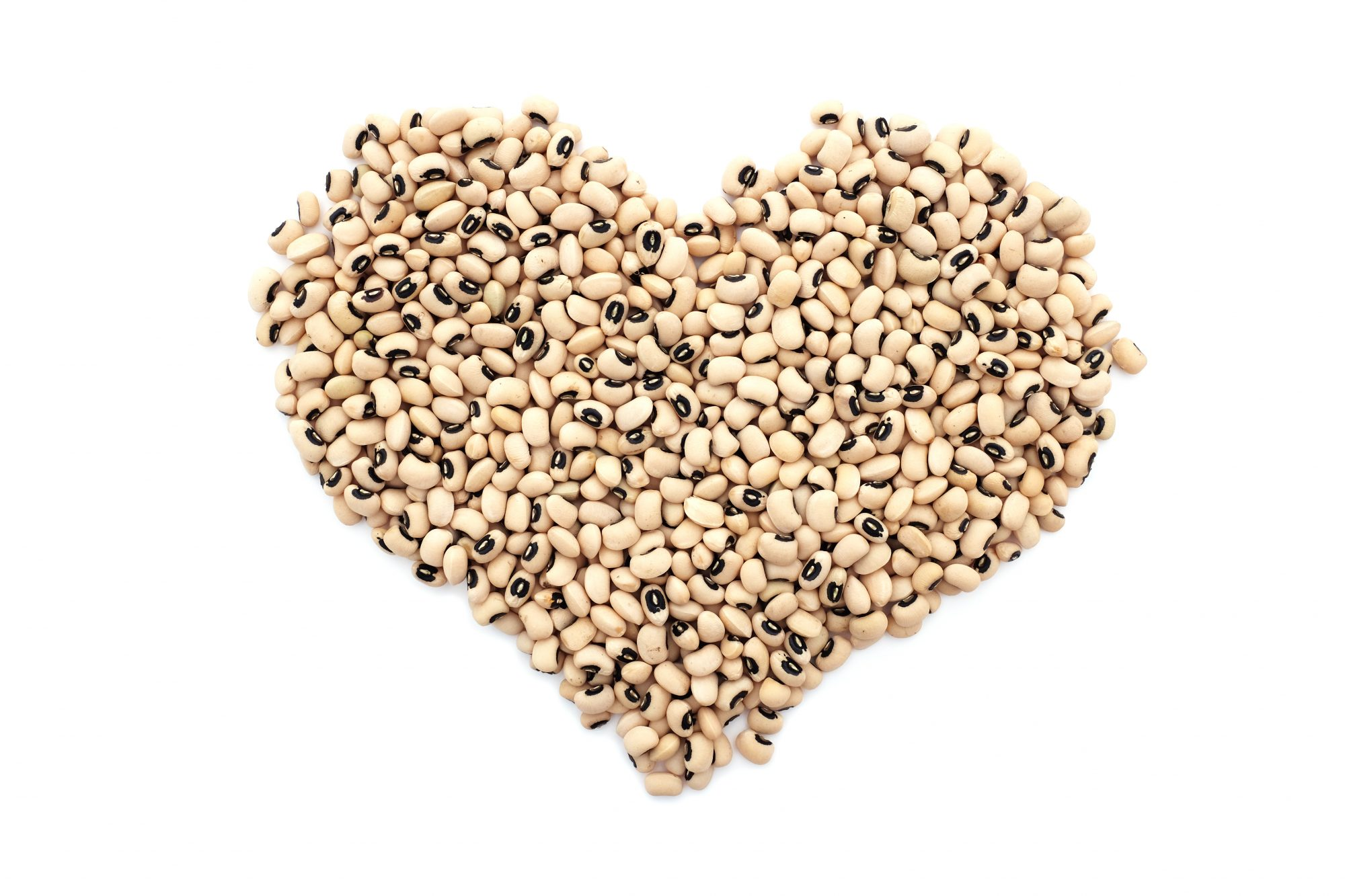 Black eyed beans in a heart shape, isolated on a white background