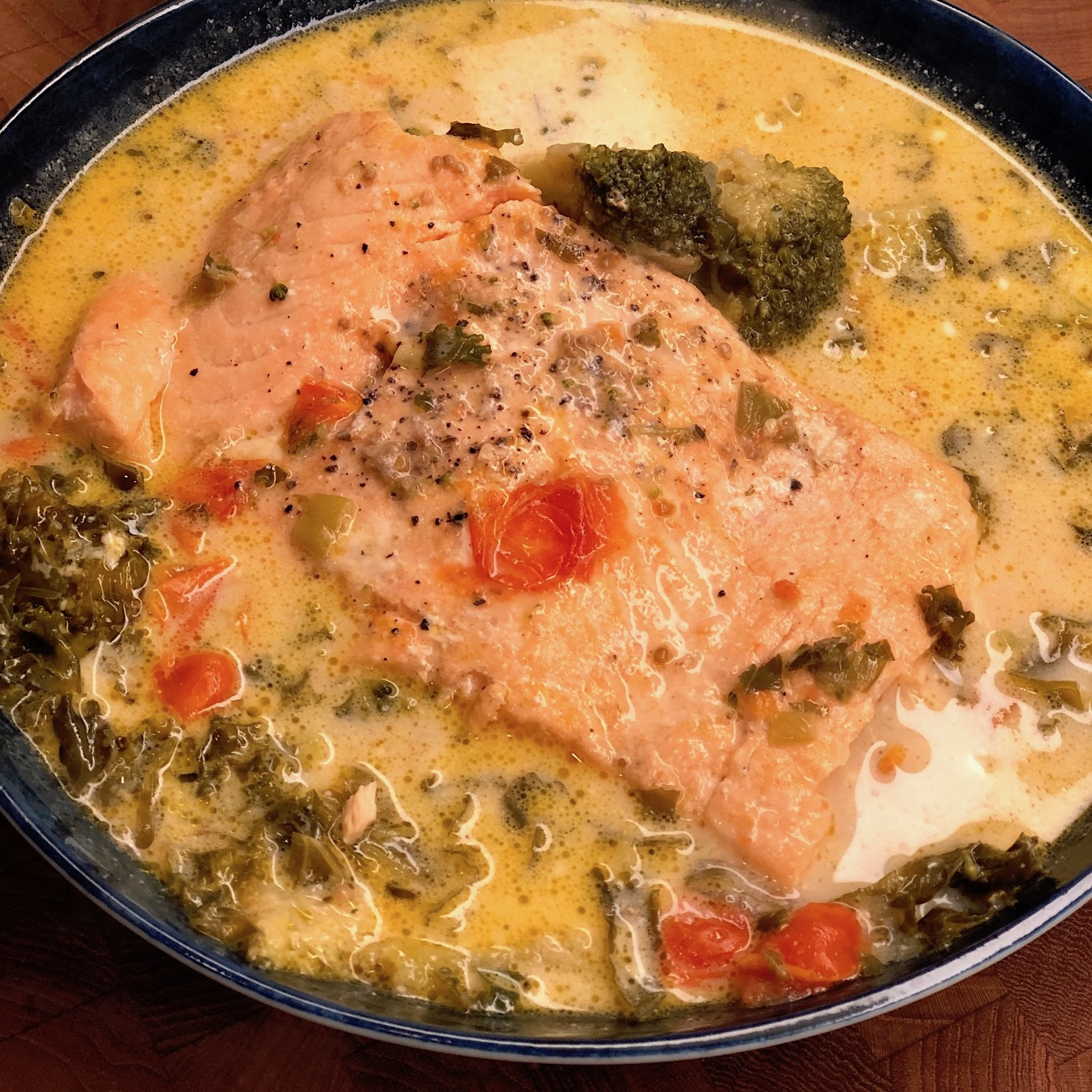 salmon and vegetables in coconut milk