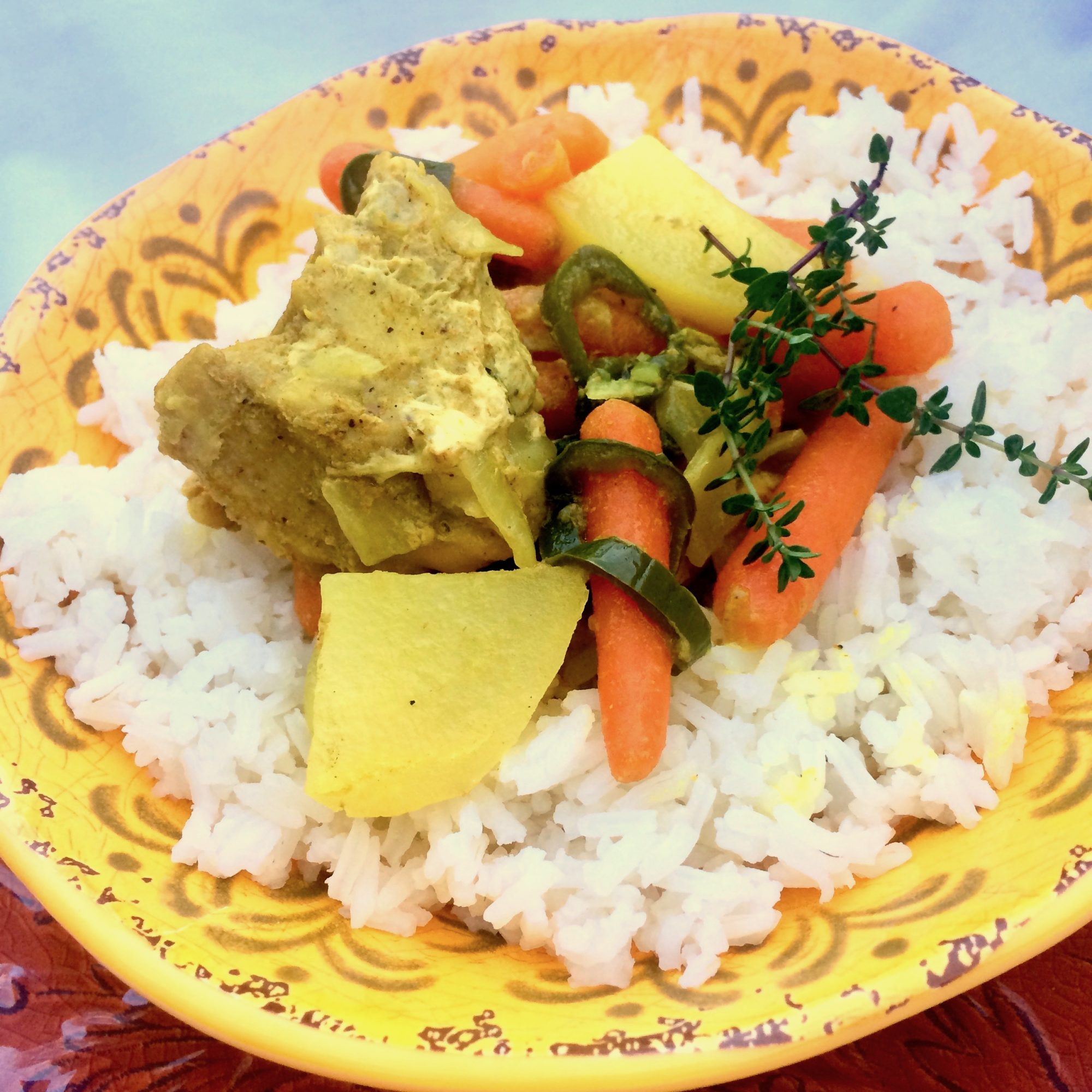 curried chicken and vegetables over rice