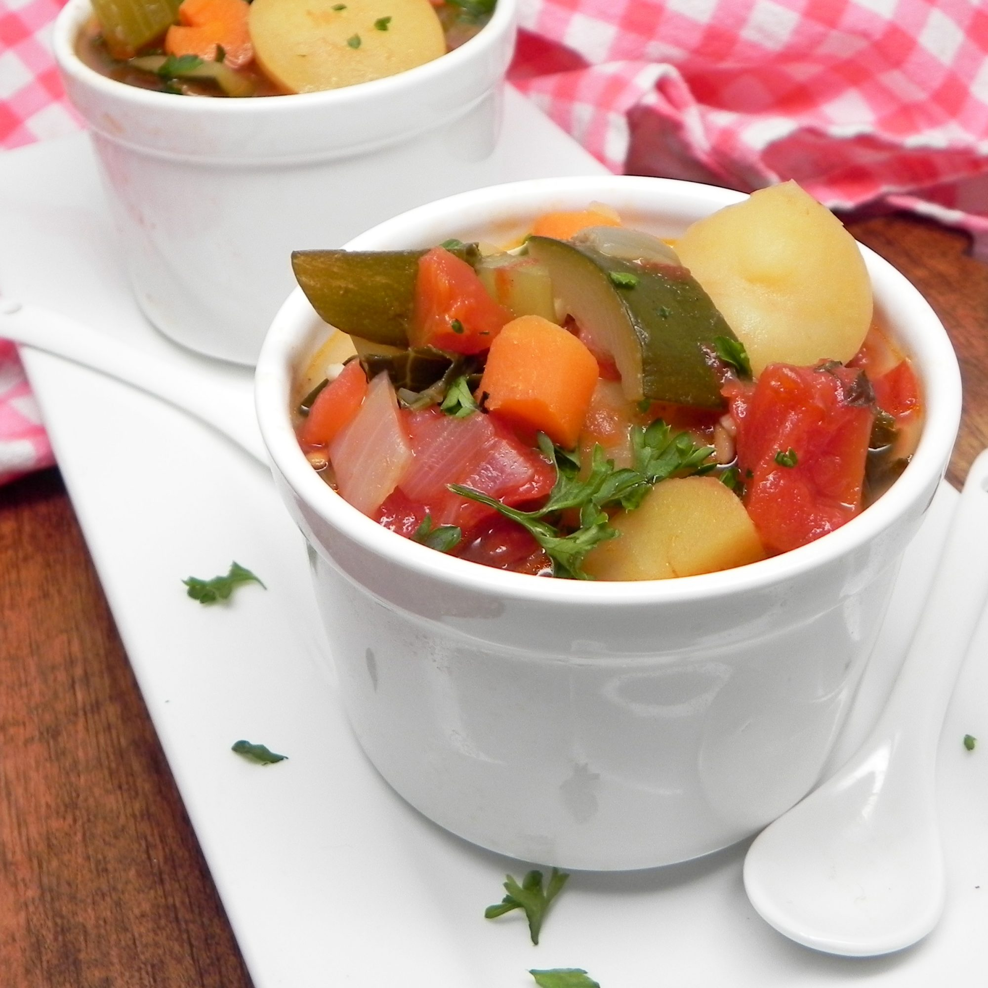 two small bowls of vegetable soup