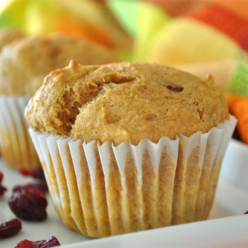 Whole Wheat Pumpkin-Applesauce Muffins on a white plate