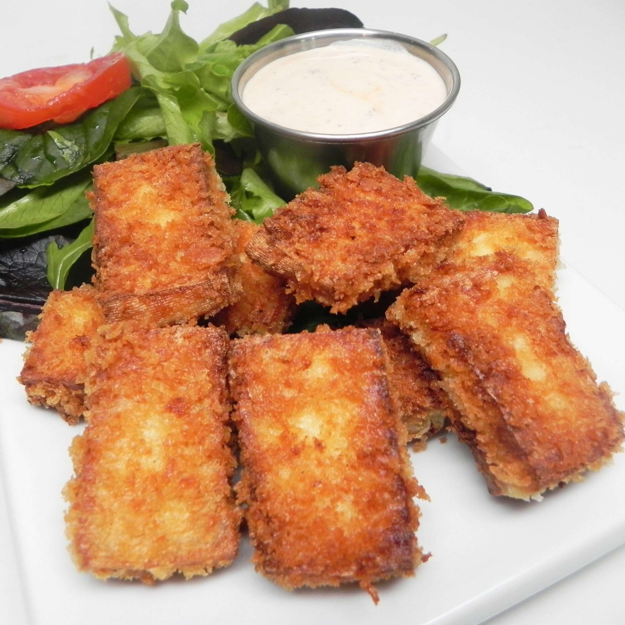 Breaded Tofu Nuggets on a white plate