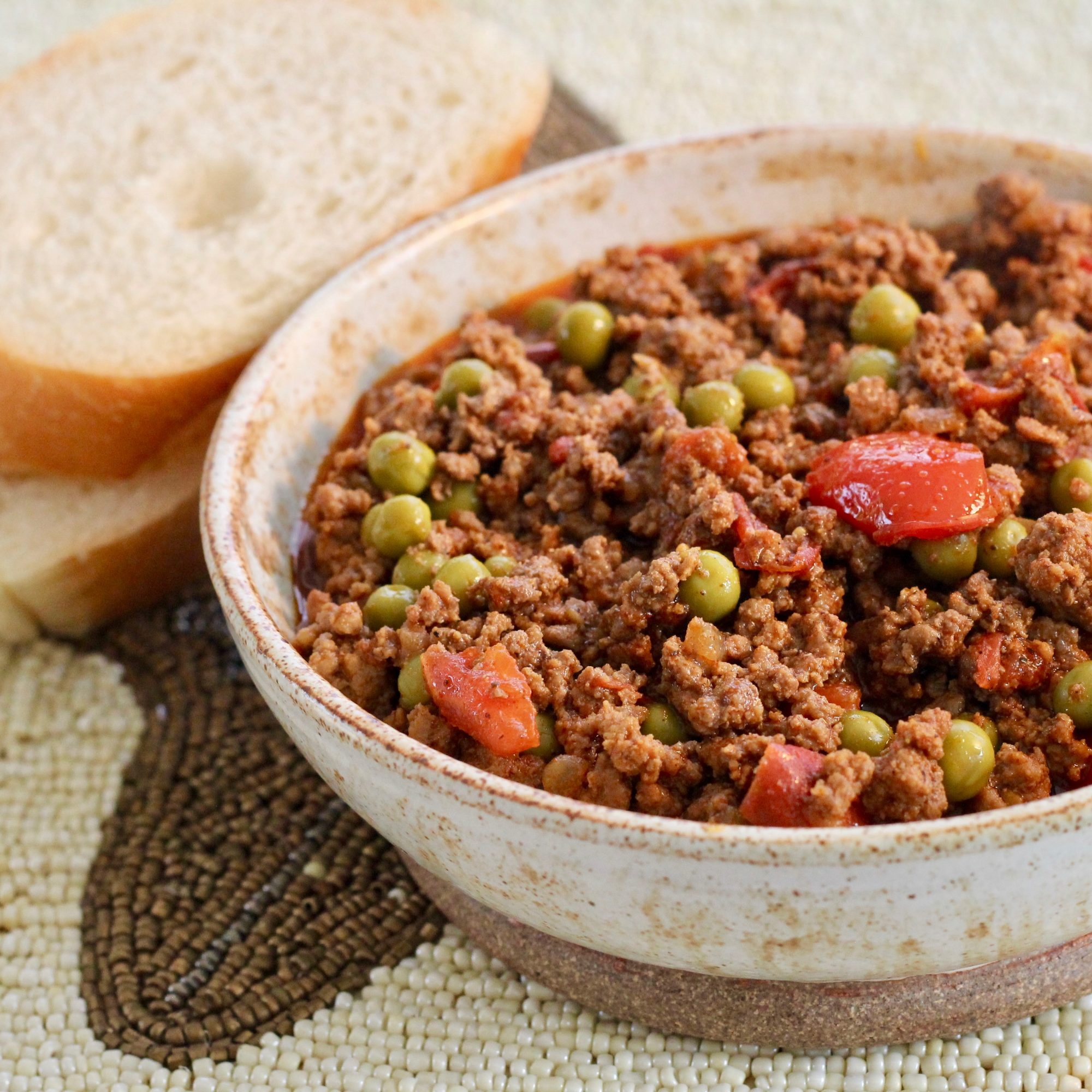 Pakistani Ground Beef Curry in a grey bowl