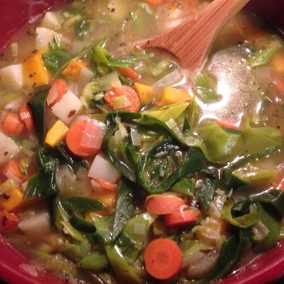kabocha squash soup with carrots and greens