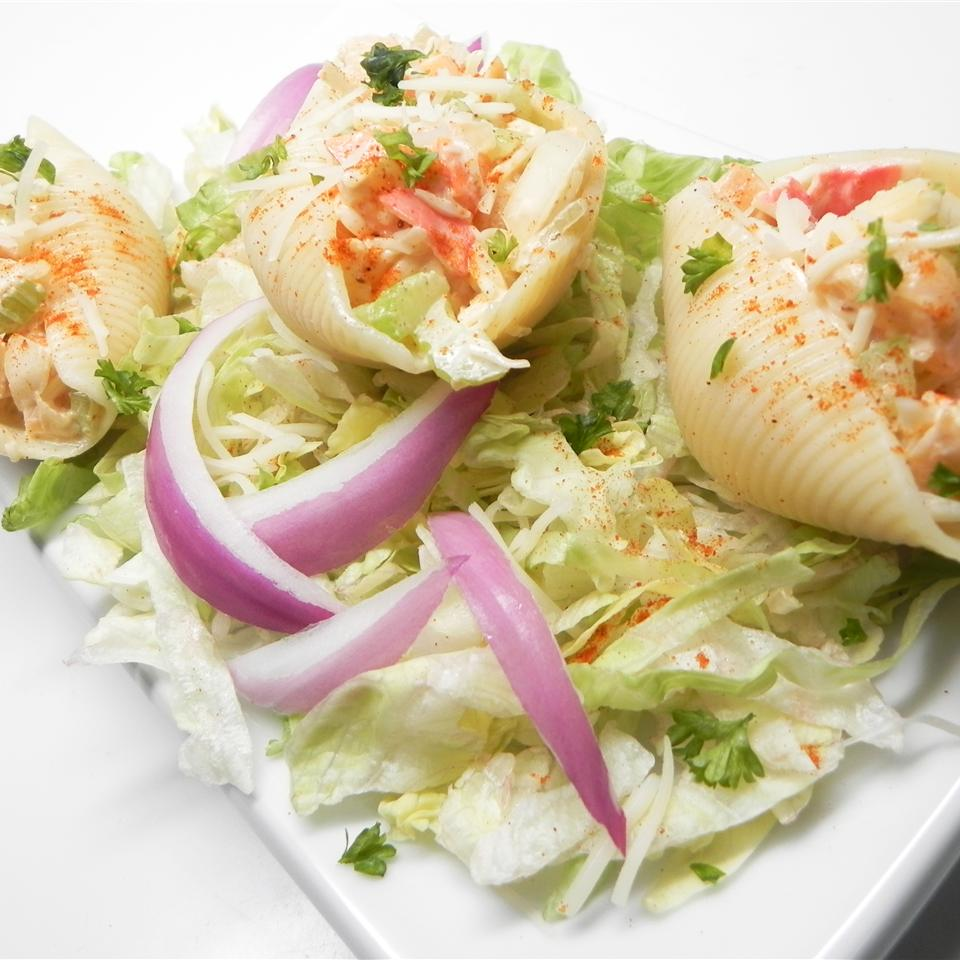 Seafood-stuffed shells on bed of lettuce