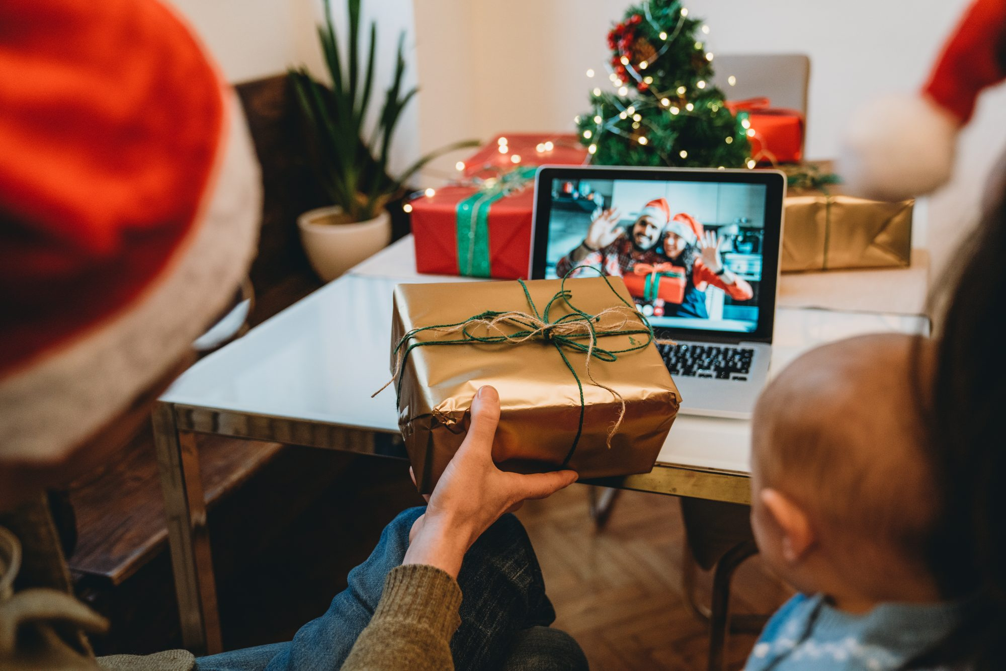 Family celebrating Christmas together with a video call