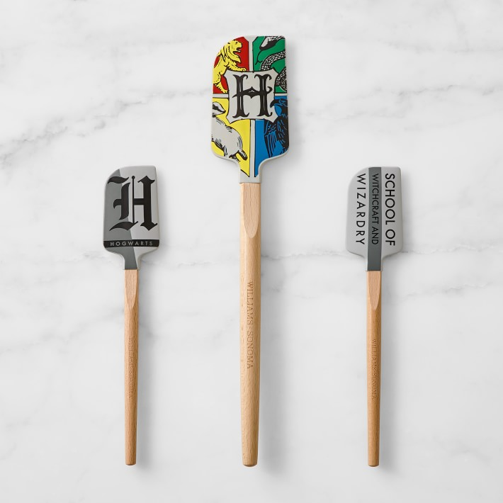 set of three Hogwarts-inspired spatulas with wooden handles