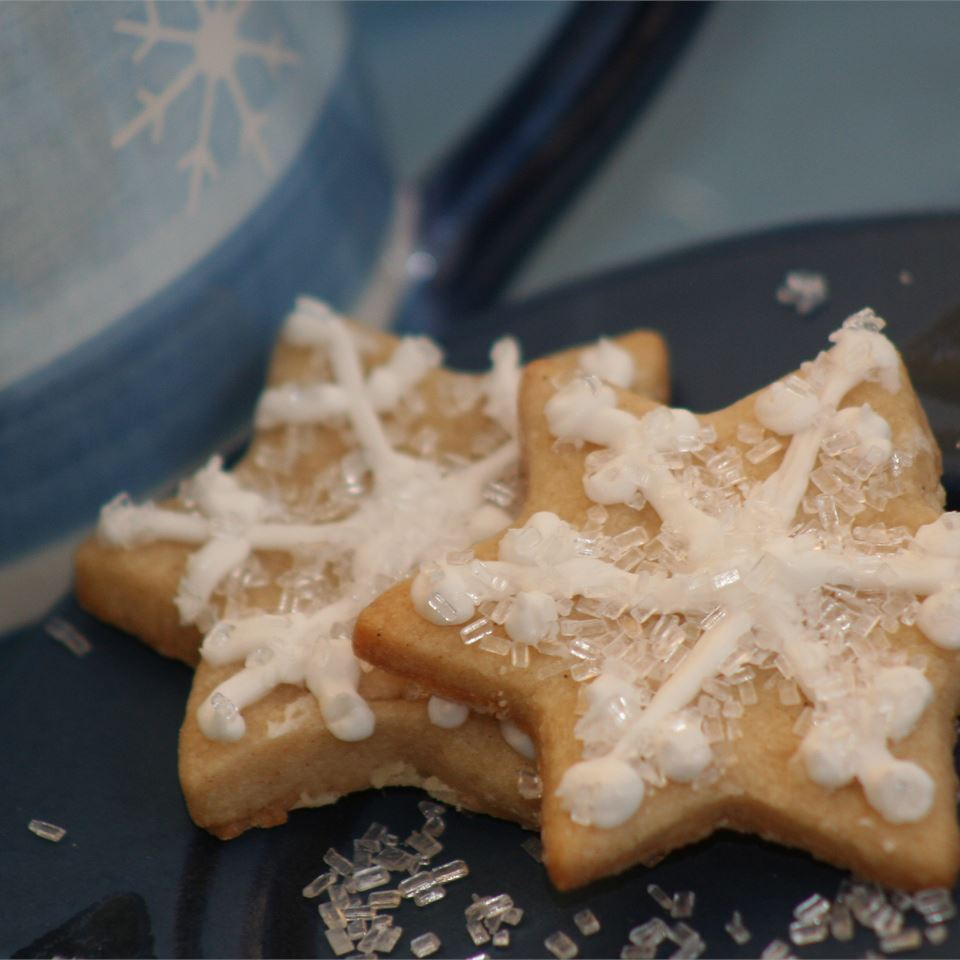 snowflake shaped cookies with clear sprinkles
