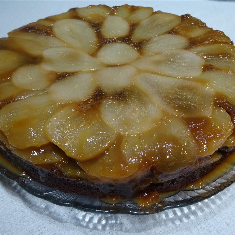 Gingerbread cake with thinly sliced, caramelized pears on top