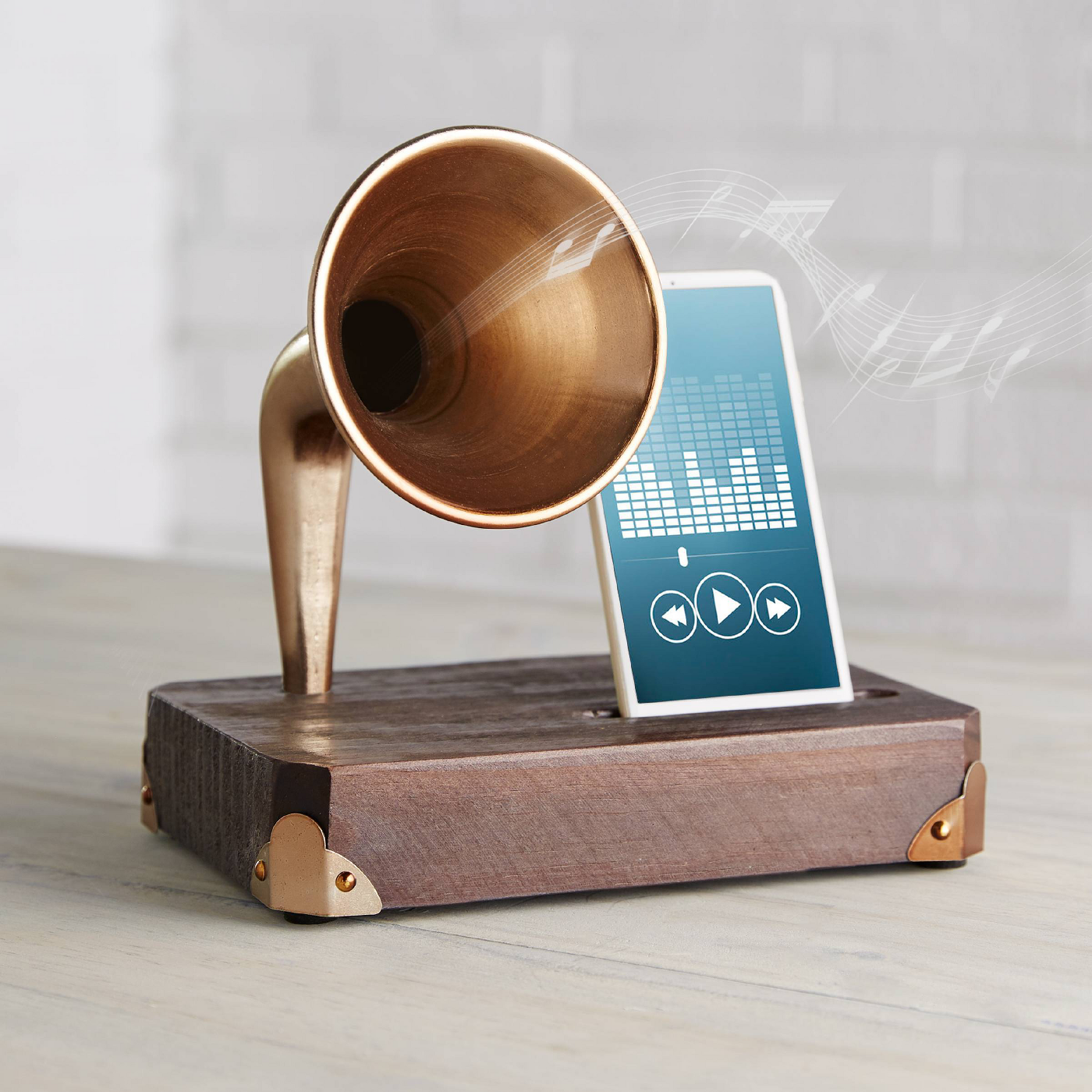 Phone docked on wooden block with golden amplifier