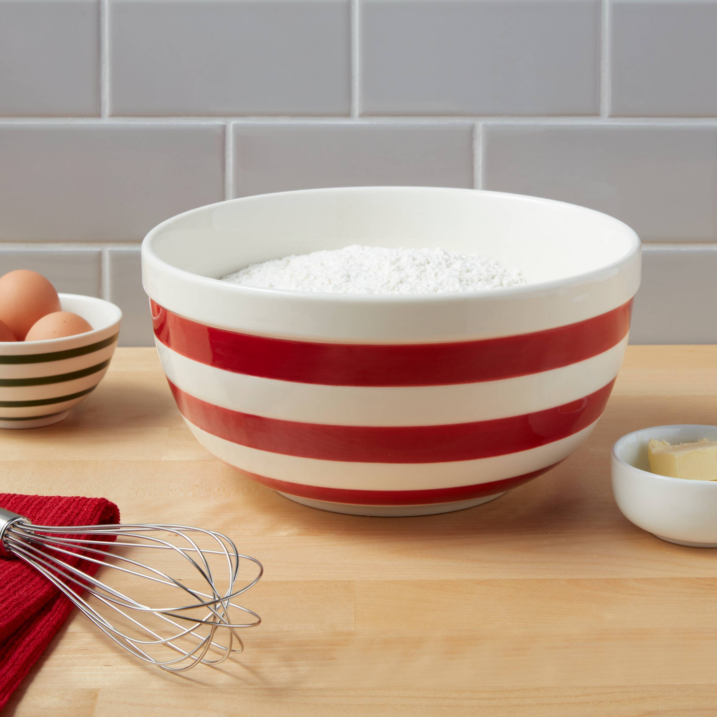 Red and white striped bowl with flour inside