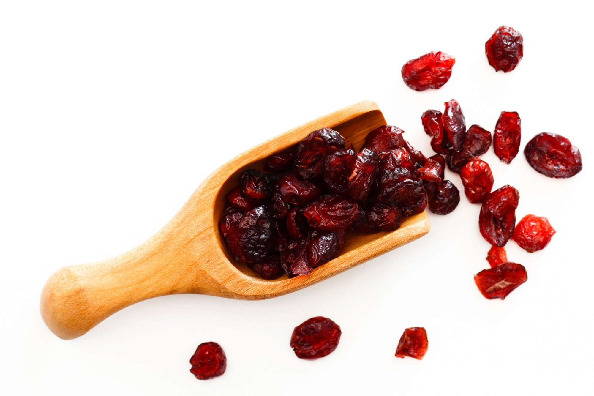 Dried cranberries with wooden scoop